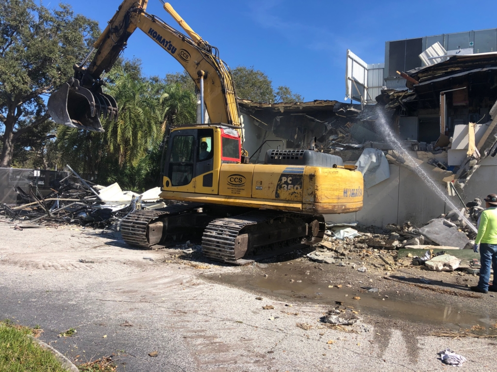 Heavy machinery tearing down a building.